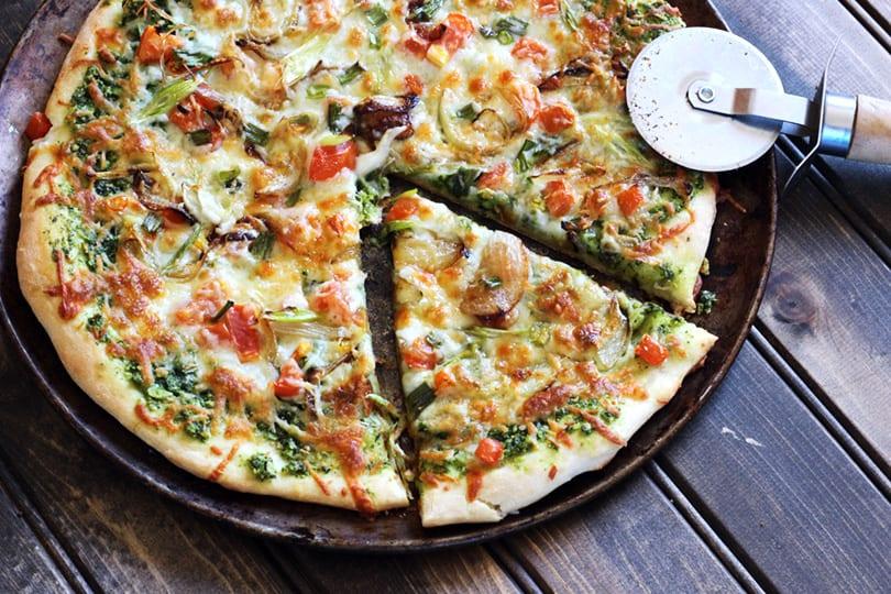 Vegan, green homemade kale pesto pizza