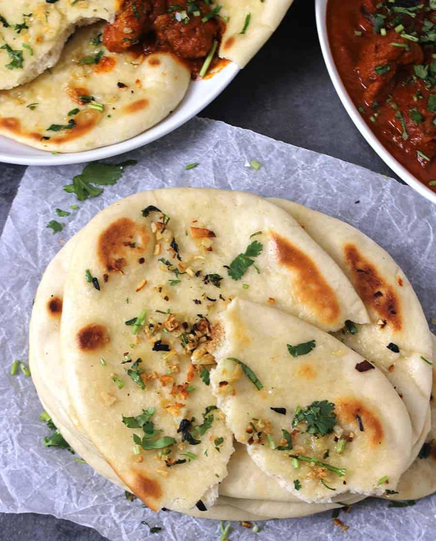 naan pizza, traditional and authentic Naan Bread Tandoori Oven , Cast Iron Skillet , Rumali Roti, Butter Chicken, Paneer Tikka Masala