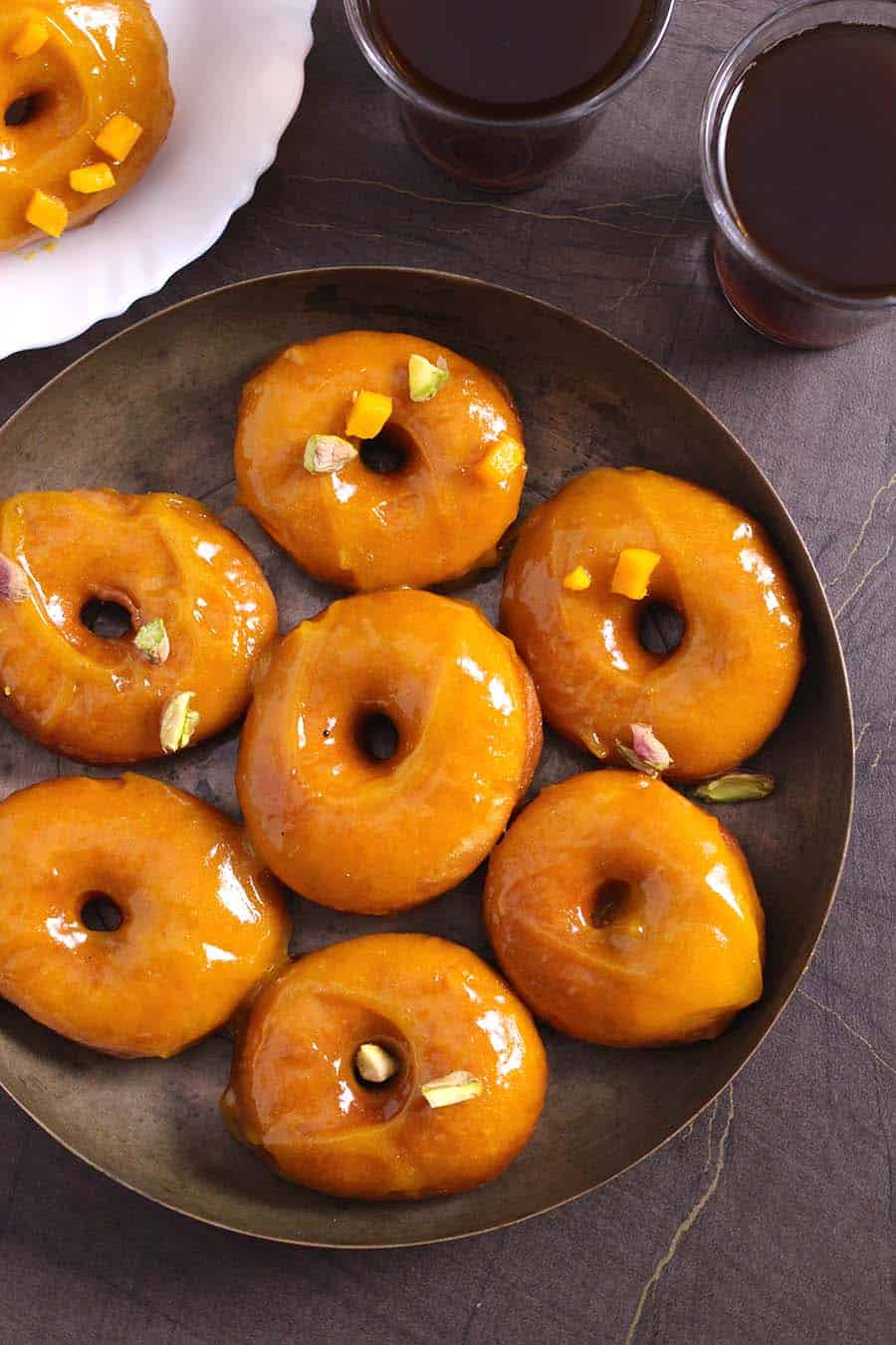 Mango glaze doughnuts (donuts) with mango glaze, Desserts for summer, thanksgiving, Christmas, holidays. Baked, fried or sir fryer donuts or doughnuts